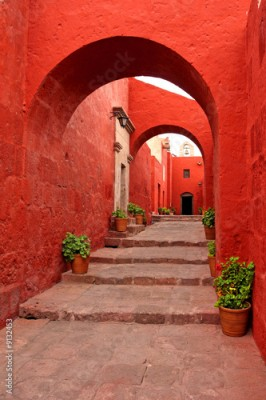 Fototapeta red old traditional building with arch