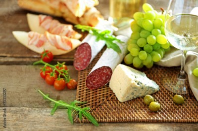Fototapeta Still life with various types of Italian food and wine