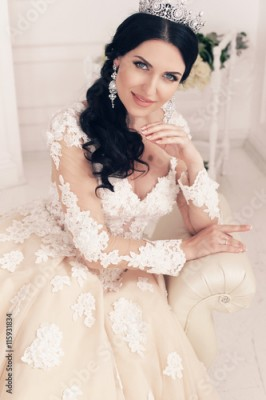Fototapeta fashion interior photo of gorgeous bride in luxurious wedding dress with accessories