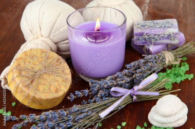 Fototapeta Still life with lavender candle, soap, massage balls, bottles,