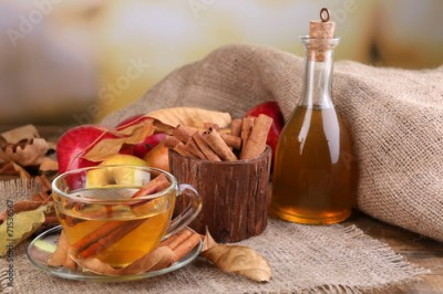 Fototapeta Composition of apple cider with cinnamon sticks, fresh apples