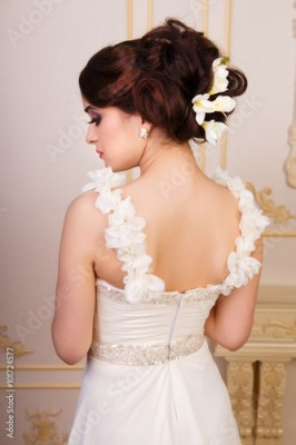 Fototapeta samoprzylepna Bridal hairstyle with accessories from the back
