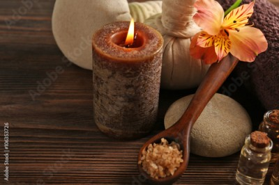 Fototapeta Spa set with sea salt, exotic flowers, candle, massage balls and towel, close up